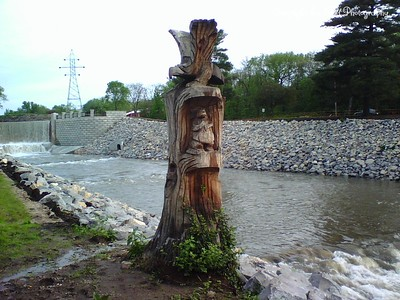 05/07/2007  Wood carving.  Lake Shawnee Spill Way.  Sometime between 7:30 and 8:30pm.  Over 12 hours since the rain stopped.