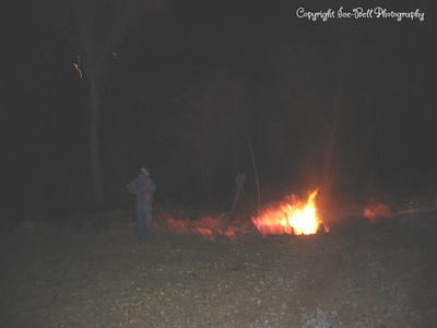 05/29/03  Liz is looking that the brush fire next to the house.