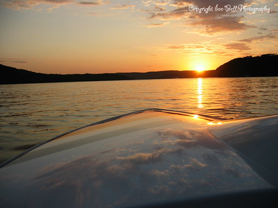 7/18/03  Sunset on Table Rock Lake.  I think dad has a good shine on the boat still as you can see the clouds on it.