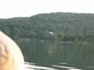 05/28/03  The new house from the lake.  It looks white with wood sticking up for the start of the roof.