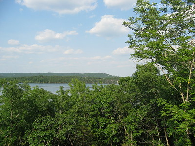 05/27/03  View from the dining room window of the new house.  You can see part of the bluff across the lake.