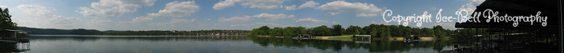 05/27/03  A panorama shot of the area that can be seen from the boat dock.  For the full effect click on the picture and wait for it to download.  You can kind a see how the land curves around right there.  The picture ends with a shot of part of the boat dock.
