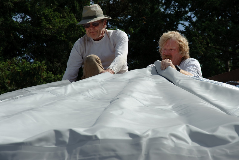 Aligning the roof -- the baby power enables vinyl to slide over the insulation more easily.