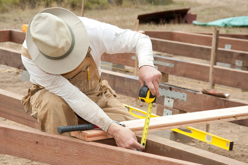 John positions the nails that will be used to support the platform insulation.