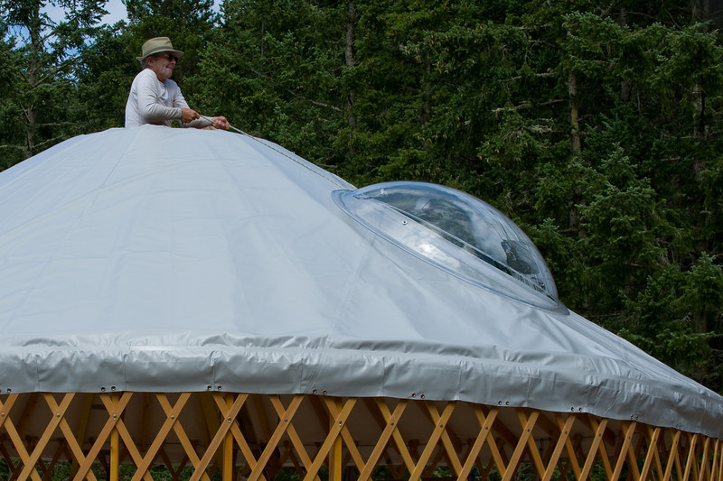 The dome is hoisted up the roof.