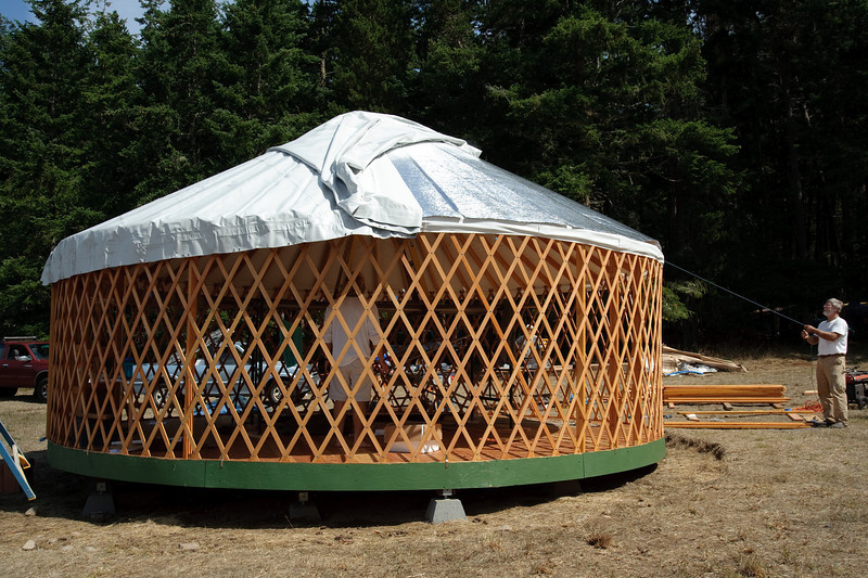The roof is unfolded like a pie crust over the rest of the yurt.