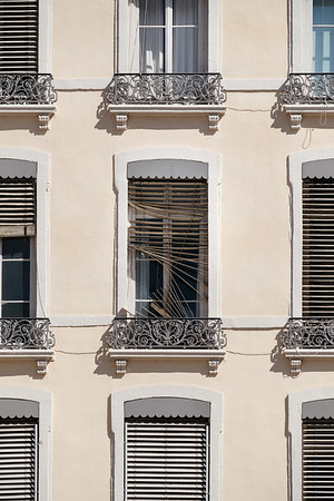 Destroyed window blinds on a facade in Lyon