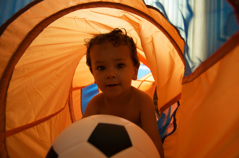 Jason's current favorite toys: his tunnel and his soccer ball.