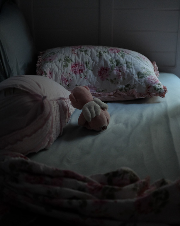 Photo of a teddy bear on a child's bed