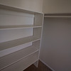 other side of master closet with built in shelves