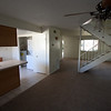 from the dinning room with a veiw of kitchen, stairs, living room and front door