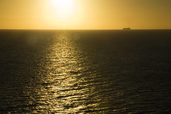 Vision of the Seas sails into the sunset.