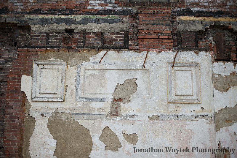 Shared wall of recently demolished building and Molar Antiques.
