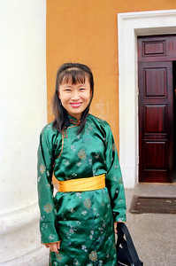 Teresa Wong dressed in Mongolian attired. Went to Mongolia for IDRC's PAN Asia Networking First All Partners Conference. The meeting took place in Gengish Khan Hotel, UB (Ulaan Baator), Mongolia in 1997. Later we went for a visit to the Gobi Desert where we stayed in a Gir (nomadic tent).