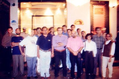 Group picture. Live Wire BBS and Nanda Netcom Pvt. Ltd Cake cutting with staff and friends