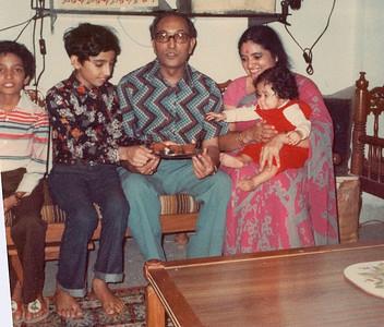 Anish, Suchit, S K Nanda, Sharda Nanda with baby Priya grabbing the cake.