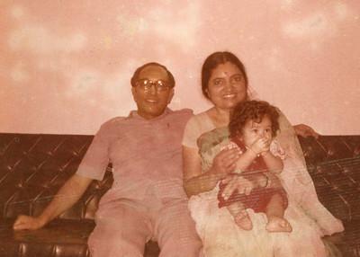 S K Nanda and Sharda Nanda with Priya in their lap.