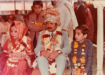 Wedding of Karan Mama and Geeta Mami. Also seen are Suchit sitting next to Mama and Sachin standing at the back.