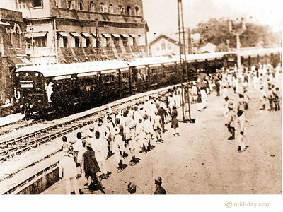 Here comes the train! One of the earliest undated pictures taken of the city's rail system depicts Bombay's commuters doing exactly the same thing in the 19th century as they do in the 21st - waiting eagerly for next train!