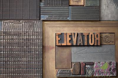 Elevator letter press