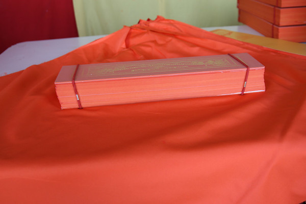 Sacred Tibetan text that is printed, wrapped, and shipped out around the world.