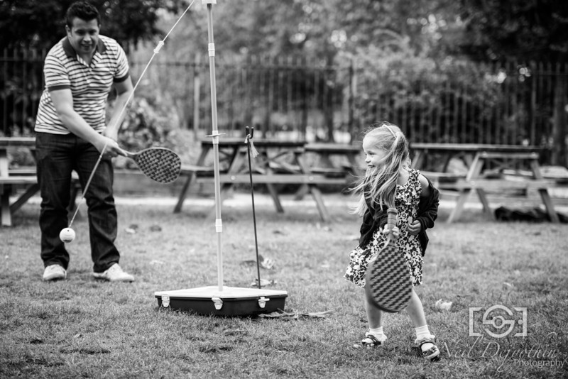 Father and daughter playing tennis at The Britannia Pub beer garden.<br /> <br /> Nikon D800 + 70-200mm 2.8 VRII