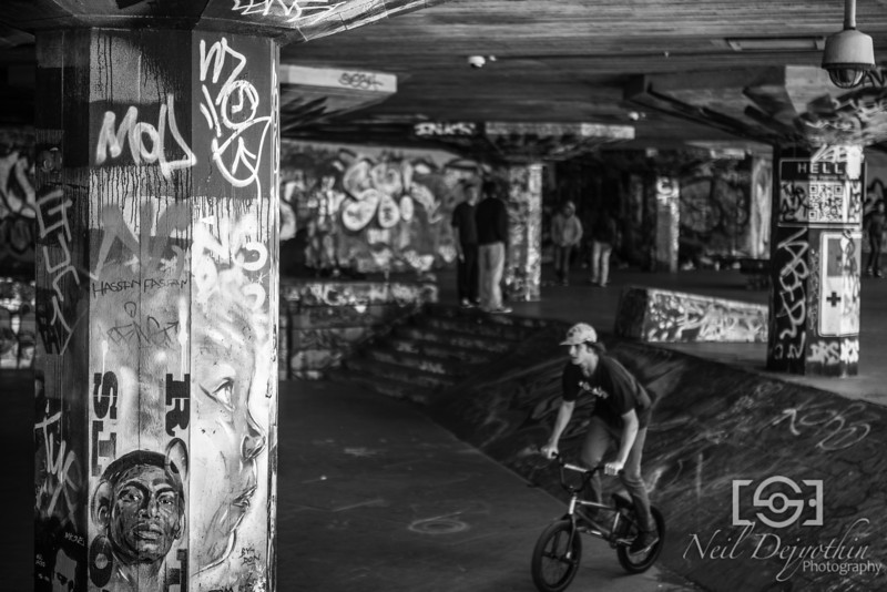 Tony Hawk's hangout<br /> <br /> The skaters area is pretty famous and probably shot to death. But you've got to try and get something cool whenever you're there and I'm really happy with this.<br /> <br /> I had intended to shoot the details of the graffiti as I approached. But I'd seen this kid cycling around on his bike and as I got here, he wasn't there obviously.<br /> <br /> But I loved the shadiness of the people loitering around in the back and I saw another two approaching them from afar. I knew I had my picture and it would have worked even without the boy cycling by, but I could see him in the corner of my eye coming in my direction and patiently waited for him to come down the ramp and into frame before taking the shot.<br /> <br /> Nikon D800 + 24-70mm 2.8