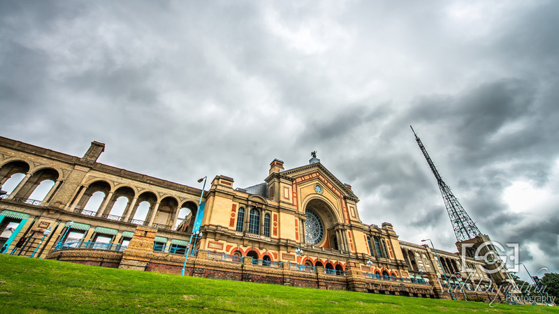 Alexandra Palace<br /> <br /> It was a wet and gloomy day. Probably not the best conditions to go and shoot in, but I still thought I got an interesting shot in the end.<br /> <br /> I positioned myself so that I could obscure the road in front of the palace. It's difficult to get a clean shot of this building because of all the lamposts, people, cars and buses that go by. I had to be patient, but my angle also helped eliminate most of that clutter.<br /> <br /> Nikon D800 + 14-24mm 2.8