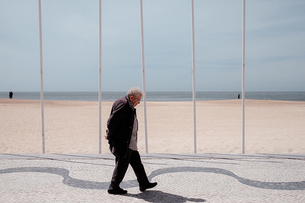 An old man walking in Nazare