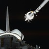 The Plasma Diagnostics Package (PDP) is grappled by the shuttle's Remote Manipulator System.