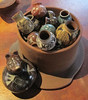 SOLD: Miniature pots in a simulated fire pit by Elena Felipe Felix and Bernadina Riviera. Price: $650