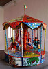 "SOLD: Wonderful. whimsical papier mache merry go round. It is 24""H without the flag. Price: $1850."