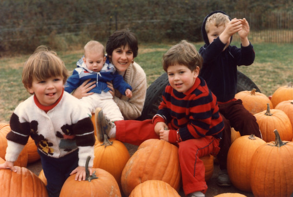 Mary holding Ben with Sam to her left front
