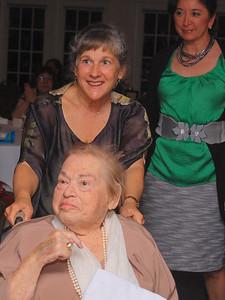 Mary wheeling Bea with Isa