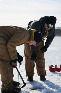Showing Nick how to scoop the ice out