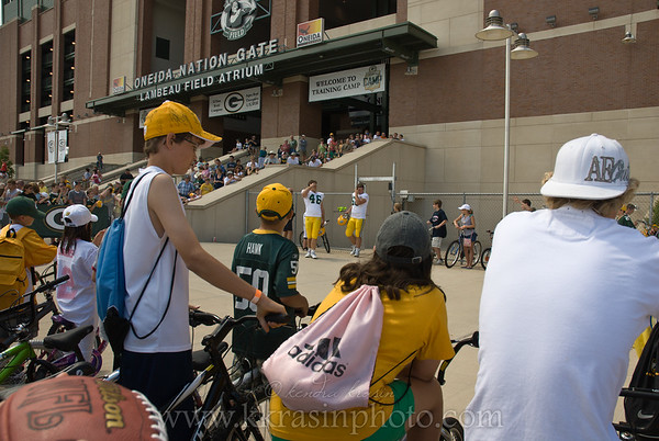Before practice, kids line up with their bikes & wait for the players to come out.