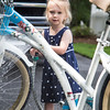 Ellie REALLY liked washing Mom's bike and the golf cart.