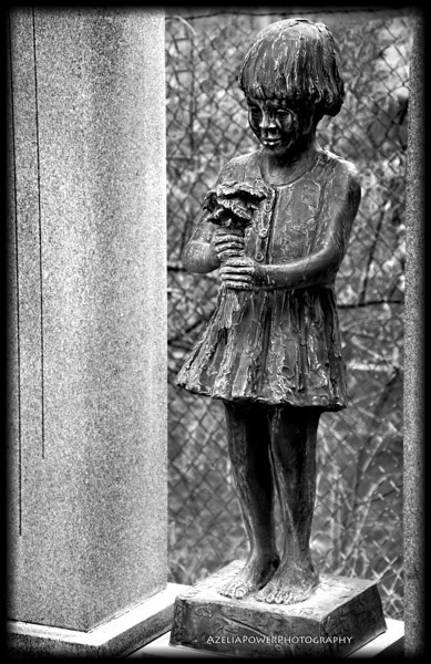 The color version of this statue was a little morbid as she has red going down from her eyes ...I chose to de-saturate because i found her sweet and not so much scary. :)