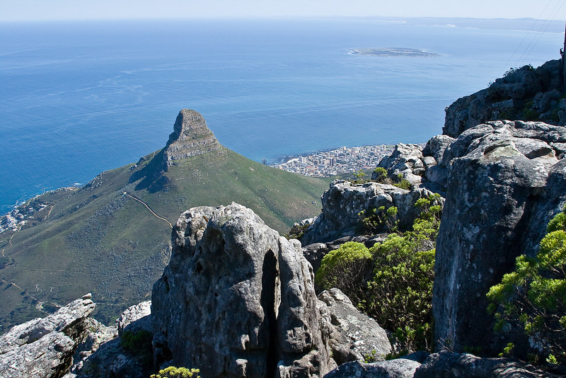 View of Lion's Head from the top of Table Mountain with Robben Island in the distance
