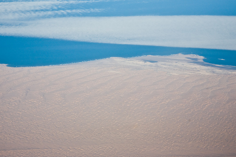 THE END.   On my way home, from about 34,000 feet.  Along the Skeleton Coast where the Namibi desert meets the Atlantic Ocean