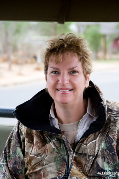 Bev is all smiles after seeing a leopard in the first 2 hours of her safari. Amazing luck ! edit