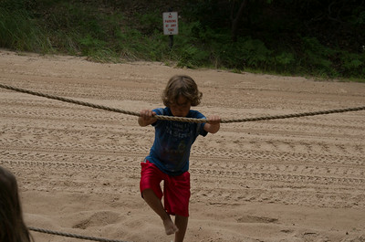 Dylan hanging on the rope.  On the other side of him is the road leading to the top of the dune for vehicles.
