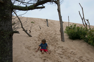 Dylan playing in the sand going down the dune hill.