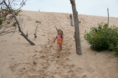 Ada running down the hill of the dune.