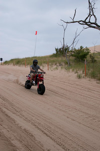 One of the many folks driving around on the dunes on there off road vehicles.