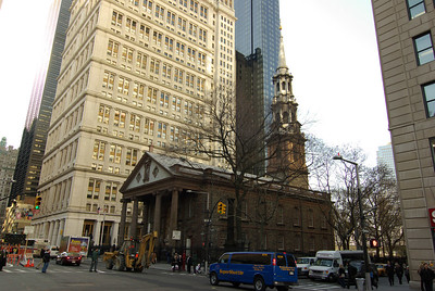 Trinity Church, at 74 Trinity Place in New York City, is a historic full service parish church in the Episcopal Diocese of New York. Trinity Church is located at the intersection of Broadway and Wall Street in downtown Manhattan. In 1696, Governor Benjamin Fletcher approved the purchase of land in Lower Manhattan by the Anglican community for construction of a new church. The parish received its charter from King William III of England on May 6, 1697. Its land grant specified an annual rent of one peppercorn due to the English crown.  The present day Trinity Church, designed by architect Richard Upjohn, is considered a classic example of Gothic Revival architecture and is designated a National Historic Landmark for its architectural significance and place within the history of New York City. When the church was consecrated on Ascension Day May 1, 1846, its soaring Neo-Gothic spire, surmounted by a gilded cross, dominated the skyline of lower Manhattan. Trinity was a welcoming beacon for ships sailing into New York Harbor.  Though skyscrapers have risen all around it, Trinity Church still stands as a significant statement of spiritual values in the heart of downtown Manhattan and serves as a center for contemplation, worship, and Christian community.  The First Trinity Church  The first Trinity Church was constructed in 1698. According to historical records, the infamous privateer Captain William Kidd lent the runner and tackle from his ship for hoisting the stones.  In 1705, Queen Anne of England increased the parish's land holdings to 215 acres (870,000 m²). In 1709, William Huddleston founded Trinity School as the Charity School of the church, and classes were originally held in the steeple of the church. And in 1754, King's College (now Columbia University) was chartered by King George II of Great Britain and instruction began with eight students in a school building nearby the church.  During the American Revolutionary War the clergy were required to be Loyalists, while the parishioners included some members of the First and Second Continental Congresses.  The church was destroyed in the Great New York City Fire of 1776 following the capture of the city by the British in the Battle of Long Island. The fire that started in the Fighting Cocks Tavern destroyed nearly 500 buildings and houses and left thousands of New Yorkers homeless. Six days later, most of the city's volunteer firemen followed General George Washington north.  In 1784, the Rev. Dr. Samuel Provoost, is appointed Rector of Trinity (1784-1800) and the New York State Legislature ratifies the charter of Trinity Church, deleting the provision that asserted its loyalty to the King of England. Whig patriots are appointed as vestrymen.  In 1787, the Rev. Provoost is consecrated as the first Bishop of the newly formed Diocese of New York.  And in 1789, following his inauguration at Federal Hall, George Washington attends Thanksgiving service, presided over by Bishop Provoost, at St. Paul's Chapel, a chapel of the Parish of Trinity Church. He continues to attend services there until the second Trinity Church was finished in 1790.