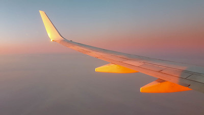 Wing view in smokey sunset