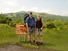 06/11/04, Joe, Doreen & Coco on the Wilburn Ridge/Rhododendron Trail which runs over the rocky crest of Wilburn Ridge in the background.