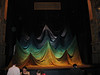"""Taken during rehearsal for the opera, The Magic Flute.<br /> This unusual drape is the actual """"curtain"""" used during the opera."""