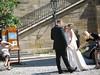Bride preparing to take a promenade on the Charles Bridge (a Prague tradition)